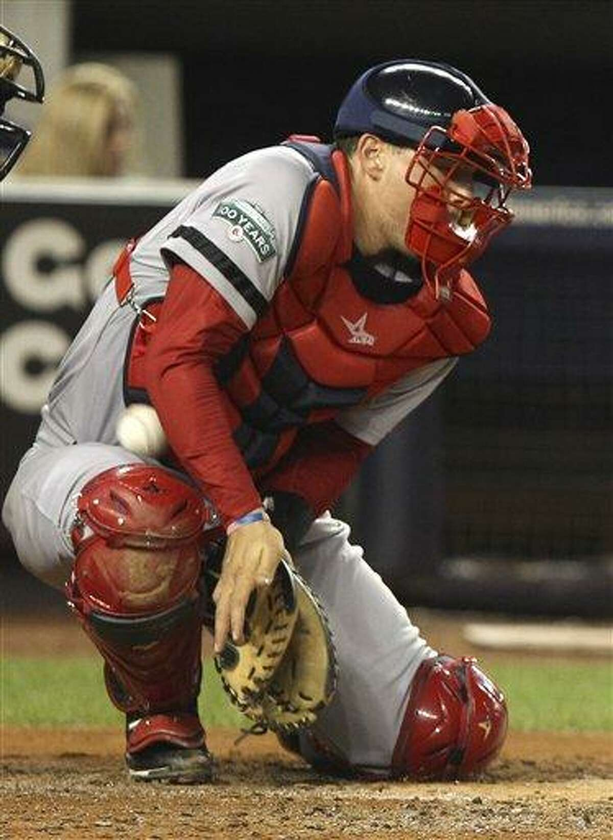 Boston Red Sox's catcher Ryan Lavarnway can't stop a wild pitch thrown by pitcher Josh Beckett, allowing New York Yankees' Derek Jeter to score during the third inning of the baseball game Sunday, Aug. 19, 2012 at Yankee Stadium in New York. (AP Photo/Seth Wenig)