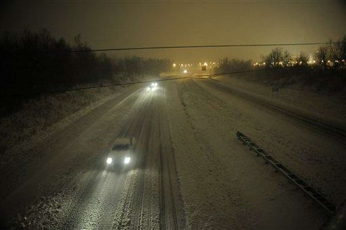 Motorists travel slowly on snow-covered Interstate 24 during a winter storm Wednesdayin Paducah, Ky. The storm dumped several inches of snow making travel hazardous. AP Photo/Stephen Lance Dennee