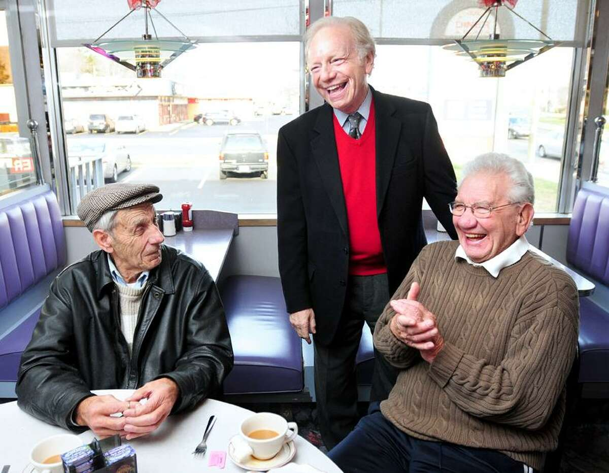 U.S. Senator Joseph Lieberman (center) talks with Robert Luciani (left), 80, of Woodbridge and Vito DeFrancesco (right), 82, of New Haven at the Athenian Diner in New Haven during a statewide tour of diners to say farewell on 12/26/2012.Photo by Arnold Gold/New Haven Register AG0478B