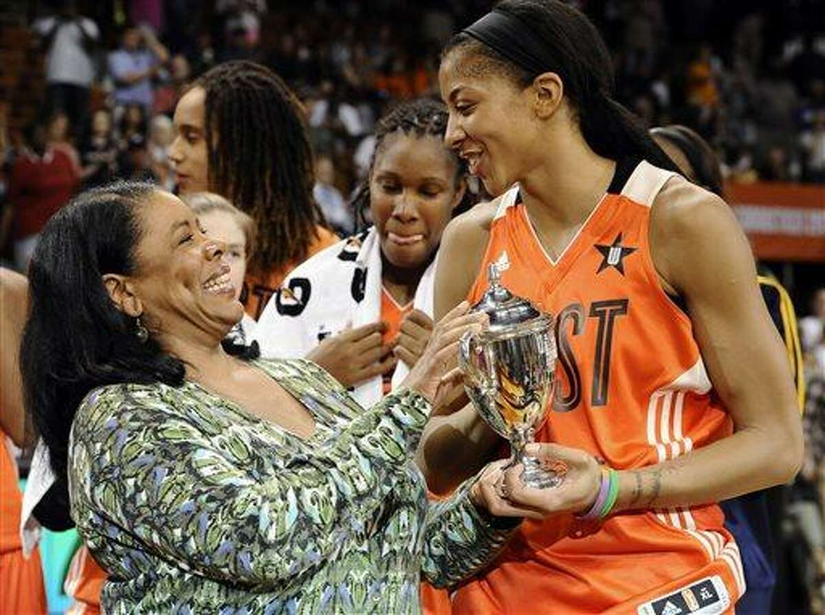 West's Candace Parker, right, of the Los Angeles Sparks, receives the MVP trophy from WNBA President Laurel Richie after the WNBA All-Star basketball game in Uncasville, Conn., Saturday, July 27, 2013. The West won 102-98. (AP Photo/Jessica Hill)