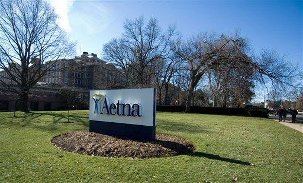 A sign for Aetna insurance is seen in Hartford in 2006. The Hartford, Conn., company said Monday that it would buy Coventry Health Care for $5.7 billion. Associated Press file photo