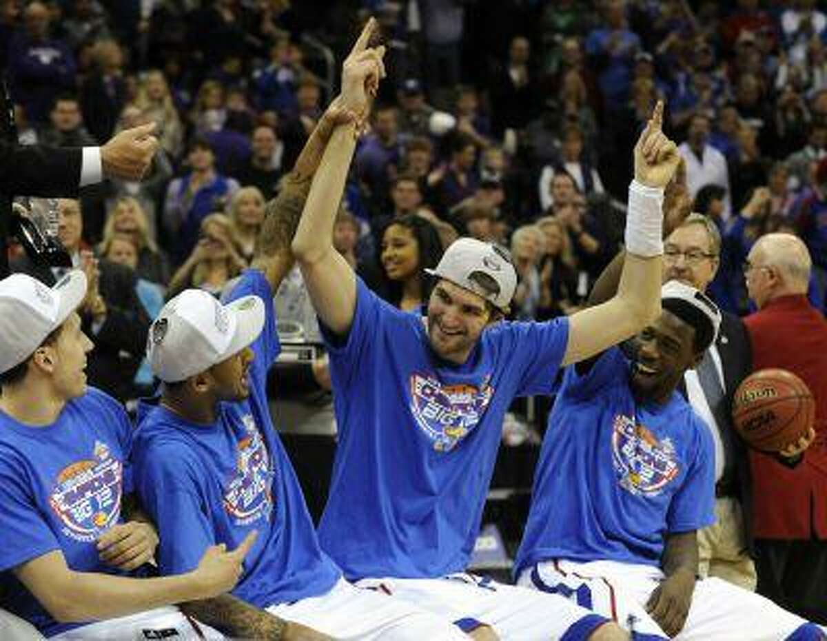 Expect Big 12 Conference champion Kansas, featuring center Jeff Withey (center), to be celebrating in Atlanta too.