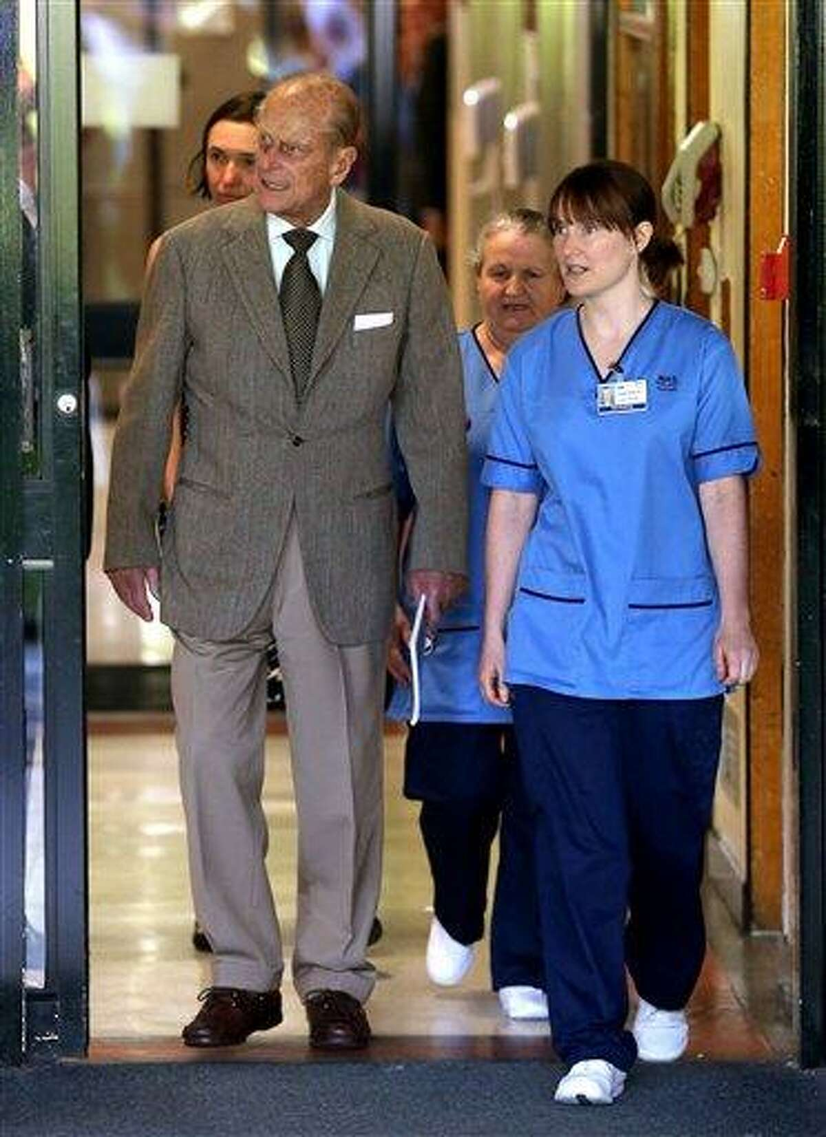 Britain's Prince Philip leaves Aberdeen Royal Infirmary, Aberdeen, Scotland Monday after five days of treatment for a bladder infection. The 91-year-old husband of Queen Elizabeth II was hospitalized Wednesday with a recurrence of an infection he suffered earlier this summer. Buckingham Palace said Philip was discharged from Aberdeen Royal Infirmary in northeast Scotland was returning to the nearby Balmoral estate, where the royal family is on vacation. Associated Press