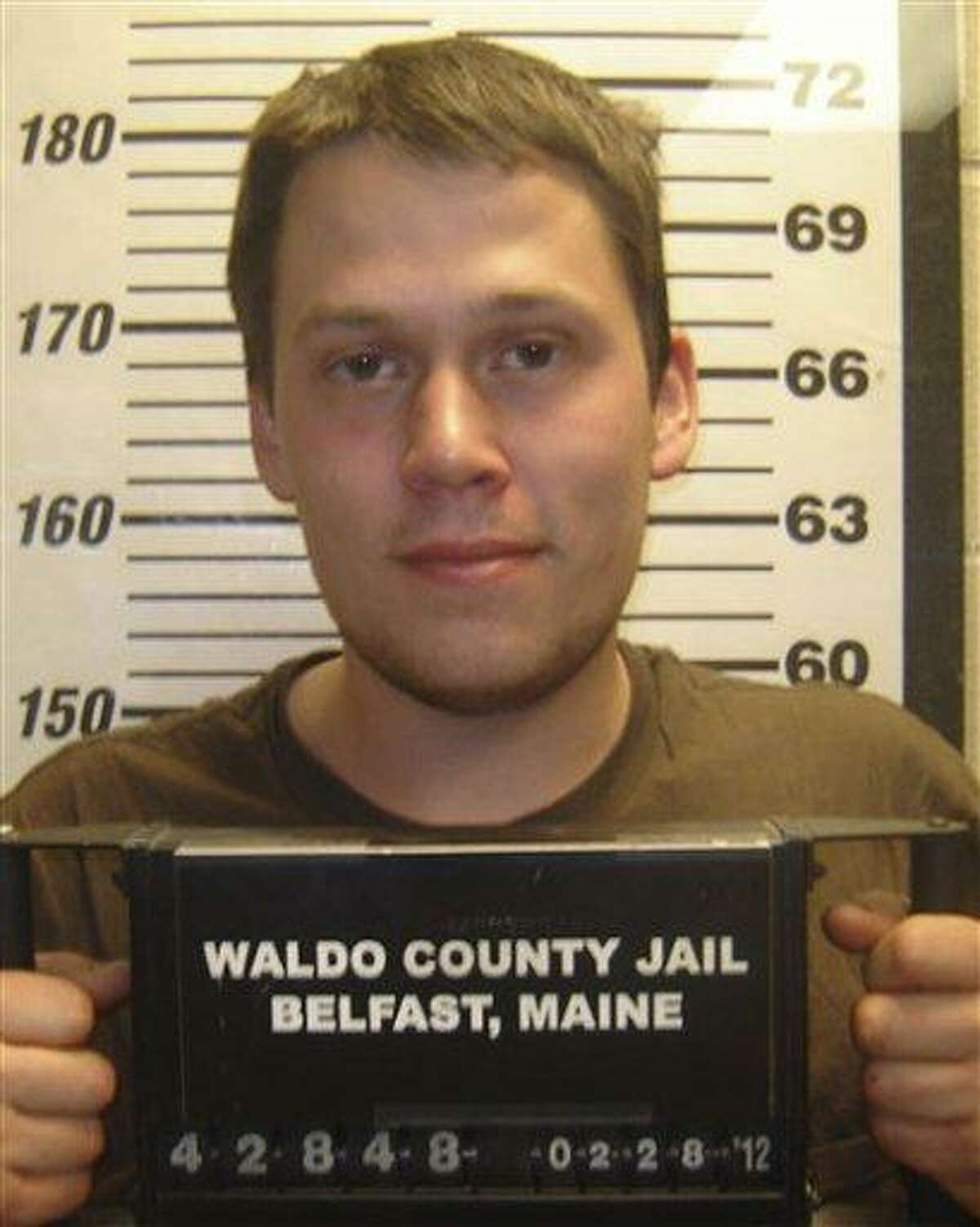 Maine police say they charged 24-year-old Daniel Porter, pictured here at the Waldo County Jail, in the death of Jerry Perdomo of Seminole County, Florida, who had been missing since Feb. 16. Associated Press