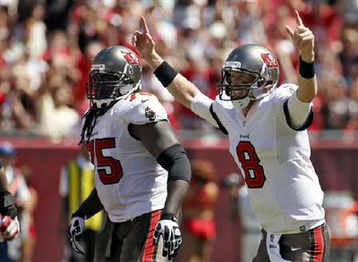 Tampa Bay Buccaneers quarterback Mike Glennon (8) and teammate guard Davin Joseph (75) on the field in September. Three of Glennon and Joseph's teammates have been diagnosed with MRSA.