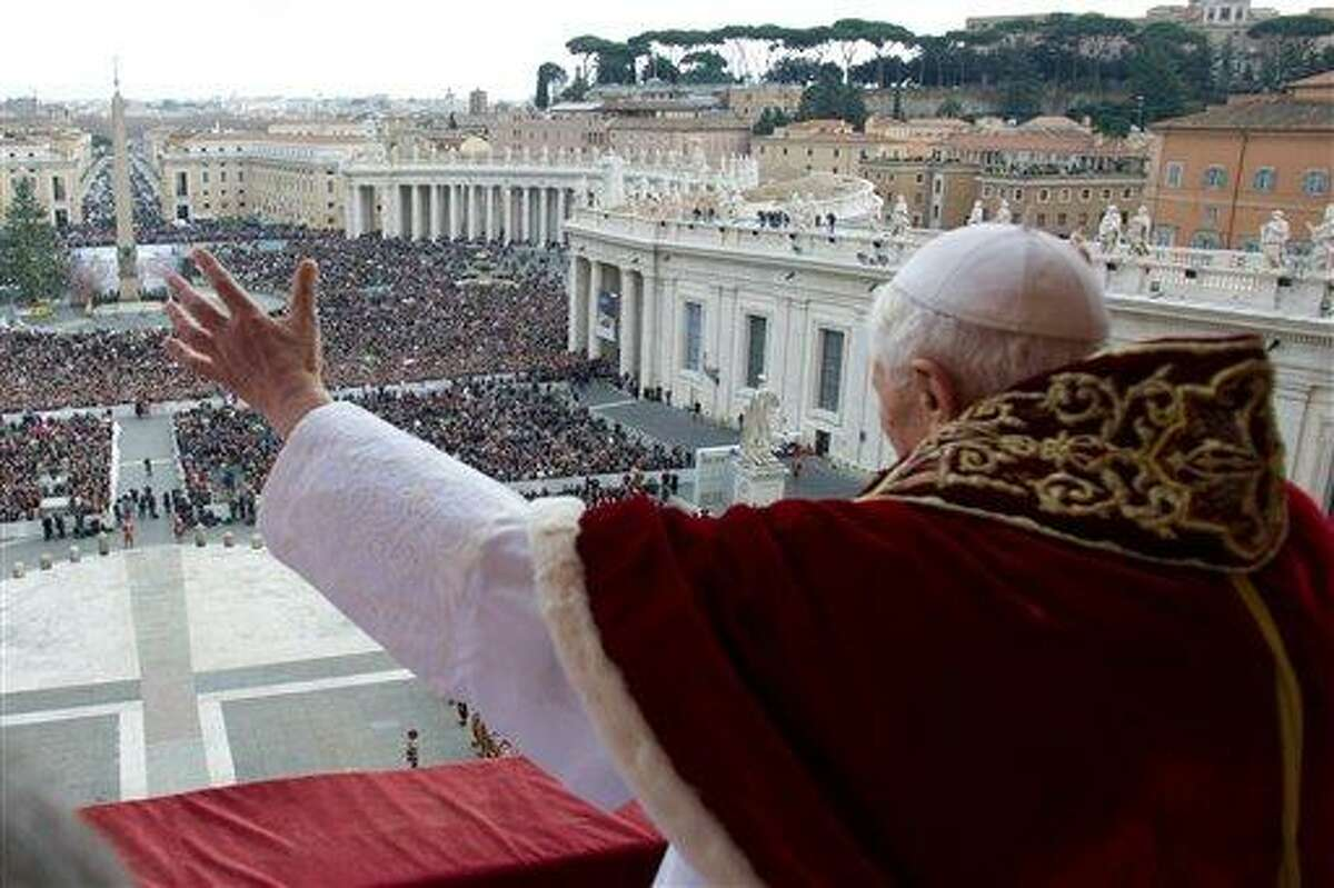"""In this photo provided by Vatican paper L'Osservatore Romano, Pope Benedict XVI delivers his """"Urbi et Orbi"""" (to the City and to the World) message from the central balcony of St. Peter's Basilica, at the Vatican, Tuesday, Dec. 25, 2012. Pope Benedict XVI wished Christmas peace to the world, decrying the slaughter of the """"defenseless"""" in Syria and urging Israelis and Palestinians to find the courage to negotiate. Delivering the Vatican's traditional Christmas day message from the central balcony of St. Peter's Basilica, a weary-looking and hoarse-sounding Benedict on Tuesday also encouraged Arab spring nations, especially Egypt, to build just and respectful societies. (AP Photo/Gregorio Borgia)"""