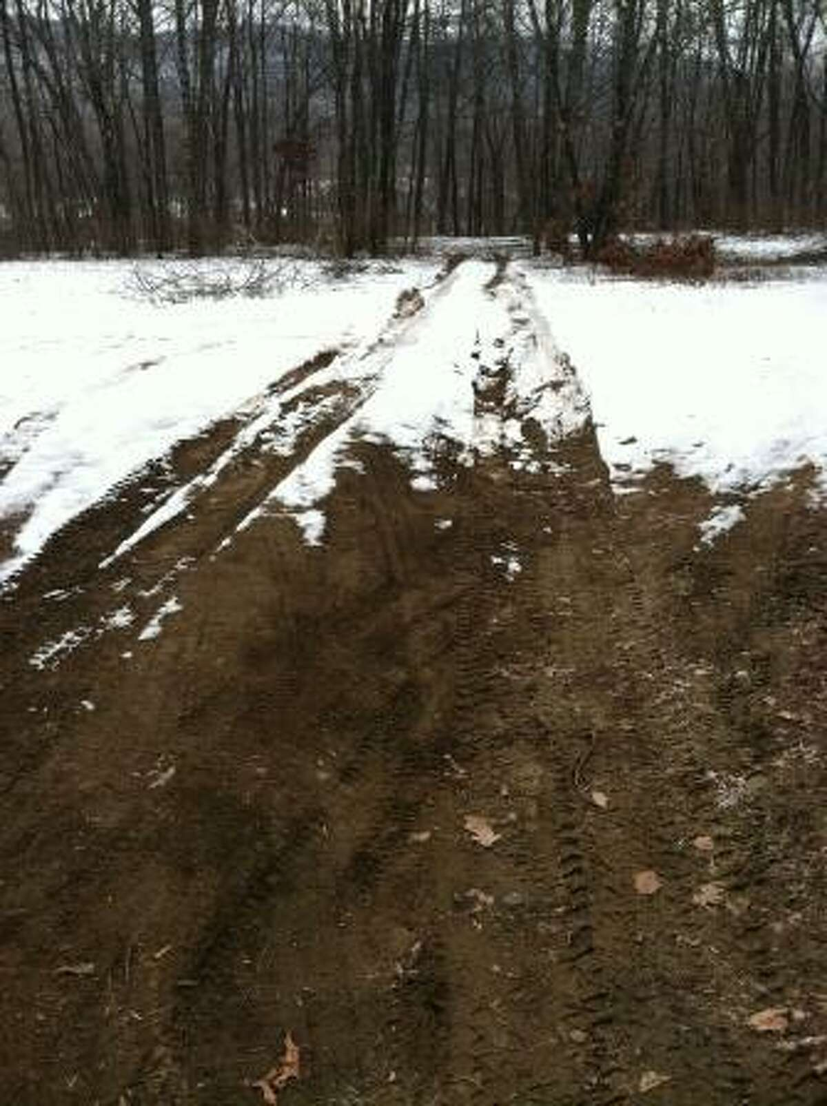 Tire tracks in the dirt and snow along River Road in Kent, in the area where the car of a missing woman from Cromwell was found Monday. Photo by Daniela Forte.