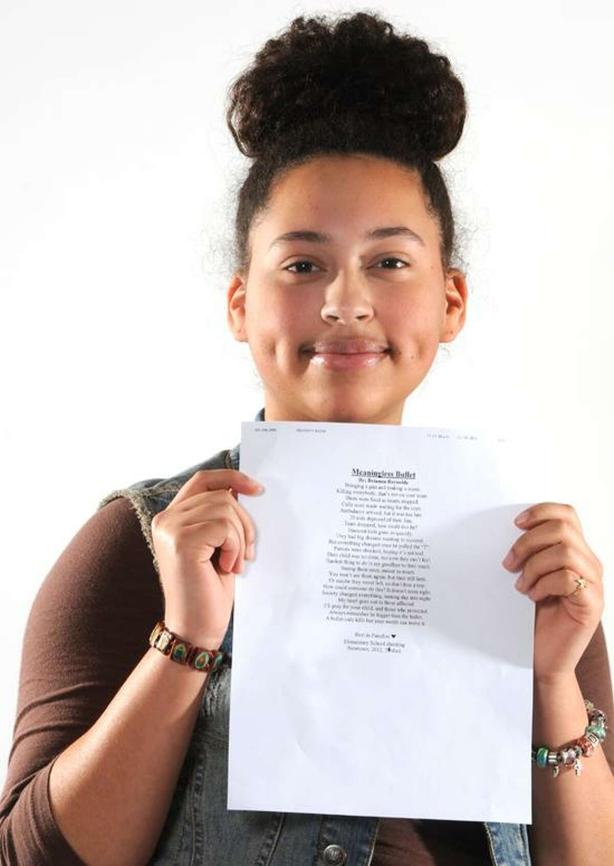 """Brianna Reynolds, 14, of West Haven wrote the poem """"Meaningless Bullet"""" about the sadness and meaningless slaughter at the Sandy Hook Elementary School Friday, December 15, 2012. Studio: Friday, December 21, 2012. Photo by Peter Hvizdak / New Haven Register."""