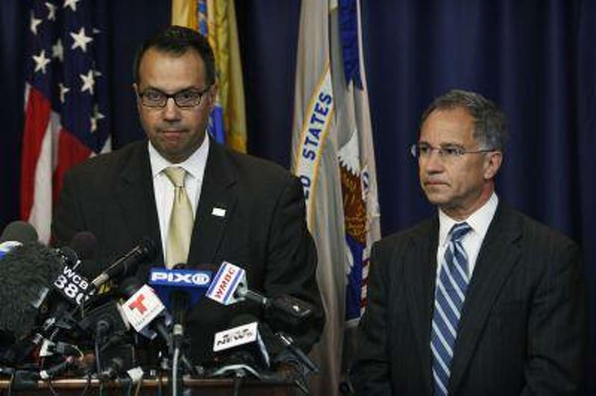 U.S. Secret Service Special Agent James Mottola (left) and New Jersey Attorney Paul J. Fishman speak to the media during a news conference in Newark, July 25, 2013. /