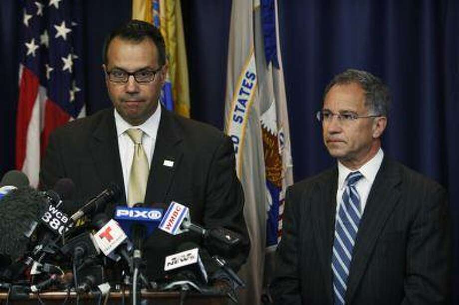 U.S. Secret Service Special Agent James Mottola (left) and New Jersey Attorney Paul J. Fishman speak to the media during a news conference in Newark, July 25, 2013. / Photo: REUTERS / X01440