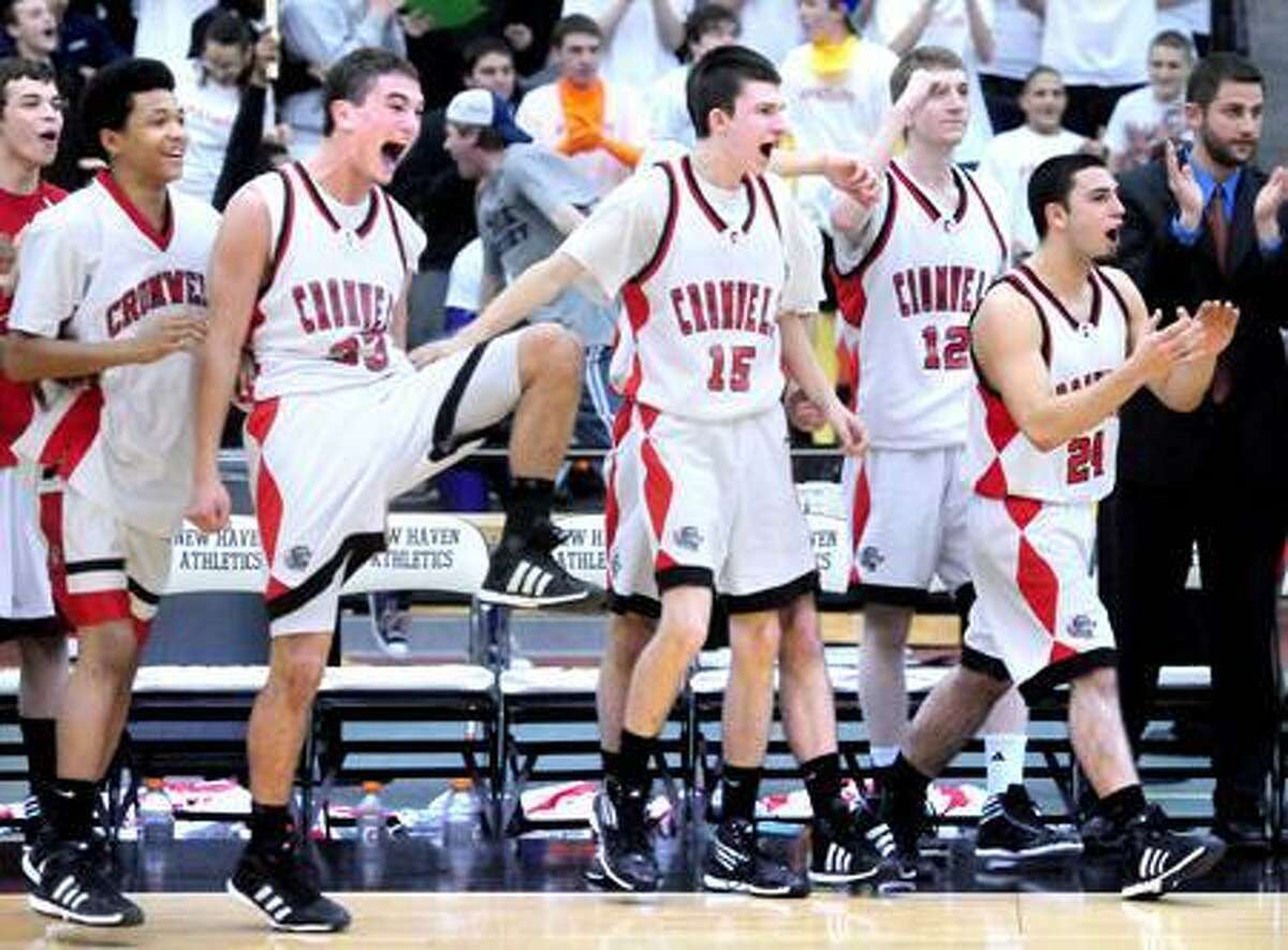 Cromwell celebrates their 64-48 victory over Valley Regional at the the Floyd Little Athletic Center in New Haven on 3/2/2012.Photo by Arnold Gold/New Haven Register AG0441D