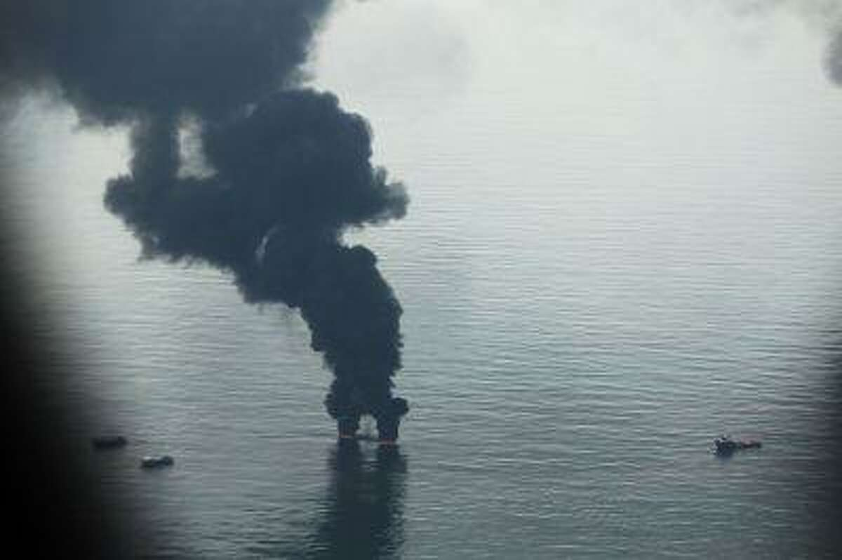 A controlled burn is viewed from the air over the site of the British Petroleum oil well in the Gulf of Mexico on June 13, 2010 off the coast of Louisiana.