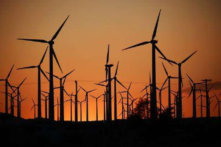 Giant turbines are powered by strong winds during sunset March 27, 2013, in Palm Springs. Photo: Getty Images / 2013 Getty Images