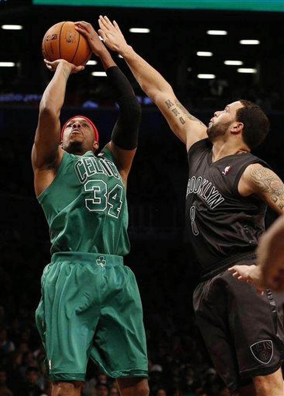 Boston Celtics forward Paul Pierce (34) shoots against Brooklyn Nets guard Deron Williams (8) in the second half of their NBA basketball game at Barclays Center, Tuesday, Dec. 25, 2012, in New York. Boston won 93-76. (AP Photo/John Minchillo)