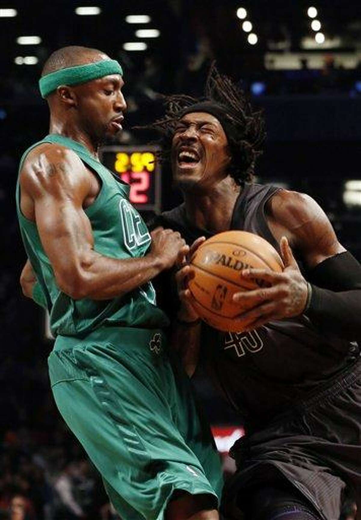 Brooklyn Nets forward Gerald Wallace (45) drives against Boston Celtics guard Jason Terry (4) in the first half of their NBA basketball game at the Barclays Center, Tuesday, Dec. 25, 2012, in New York. (AP Photo/John Minchillo)
