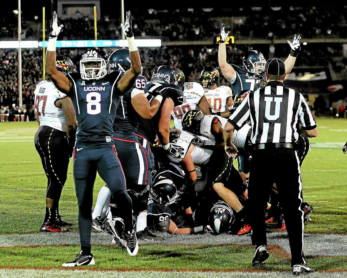 UConn wide receiver Shakim Phillips (8) will hope to celebrate more rushing touchdowns, like this one from Lyle McCombs against Maryland on Sept. 14, when true freshman Tim Boyle makes his first collegiate start Saturday against South Florida at Rentschler Field in East Hartford.