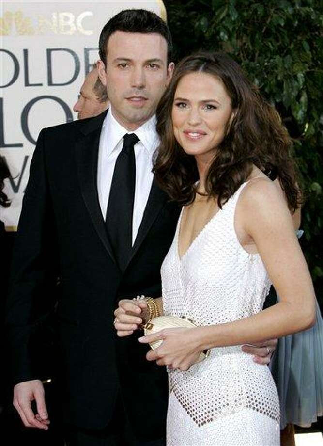 In this January 2007 file photo, Ben Affleck, left, and Jennifer Garner arrive for the 64th Annual Golden Globe Awards in Beverly Hills, Calif. Affleck has confirmed the Feb. 27 birth of his son Samuel Garner Affleck with wife actress Jennifer Garner on his official Facebook page. This is the couple's third child. Associated Pres Photo: AP / AP2007