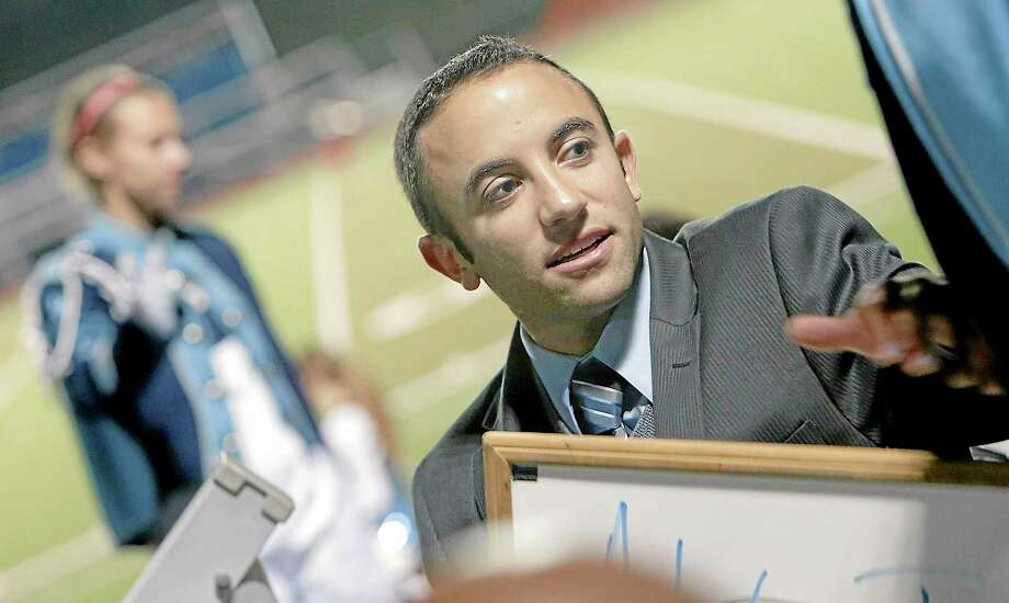 Sandy Aldieri — Special to the Press Anthony Pandolfe, the new director for the Middletown High School Marching Band in action at Friday night's Homecoming game against Hartford Public. Photo: Journal Register Co.