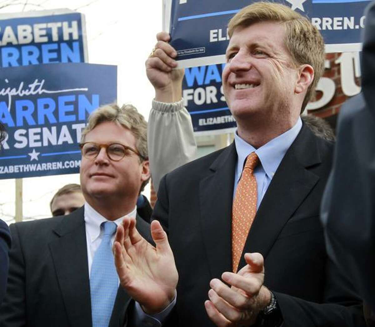 Edward M. Kennedy, Jr., left, and former U.S. Rep. Patrick Kennedy, D-R.I., right, both sons of the late U.S. Sen. Edward M. Kennedy, D-Mass., attend a campaign event for Democratic candidate for the U.S. Senate Elizabeth Warren, not shown, in the Dorchester neighborhood of Boston Monday, Nov. 5, 2012. Both Warren and incumbent U.S. Sen. Scott Brown, R-Mass., continue their push around the state on the final day of campaigning before Election Day. (AP Photo/Steven Senne)