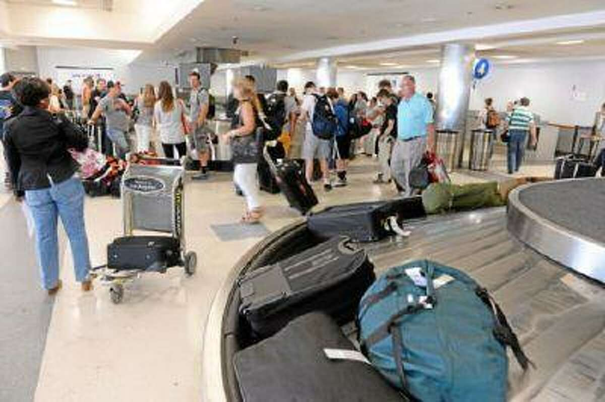 At LAX, passengers collect their baggage at the carousels at United Airlines and American Airlines. (Brad Graverson/Staff Photographer)