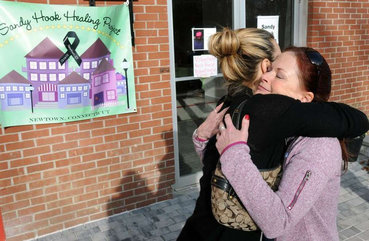 Sandy Hook Healing Project founder Heather Gunn-Rivera of New York City left embraces volunteer Reiki instructor Wendy Strauss, also of NYC, outside the Project's Newtown location. Gunn-Rivera set up the Healing Project to help those affected by the Sandy Hook shooting with a variety of therapeutic assistance. Mara Lavitt/New Haven Register12/24/12