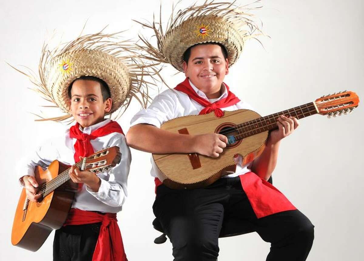 Leandro Rodriquez, 10, left, and his brother Louis Rodriguez, 12 both of West Haven, play the Cuatro. 12/21/12 December 21, 2012. Photo by Peter Hvizdak / New Haven Register.