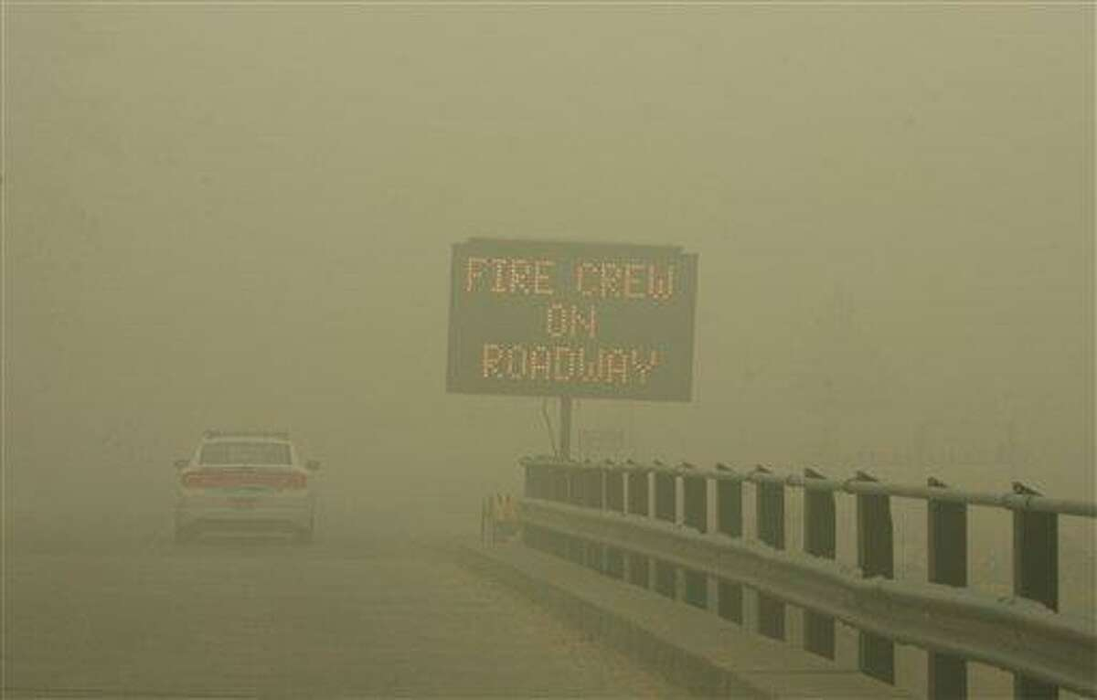Because of such poor visibility and health concerns, Elmore County Sheriff's deputies issued mandatory evacuation orders to residents of Featherville, Idaho, as the Trinity Ridge fire continued to burn on Saturday. This is the bridge over Johnson Creek. Associated Press