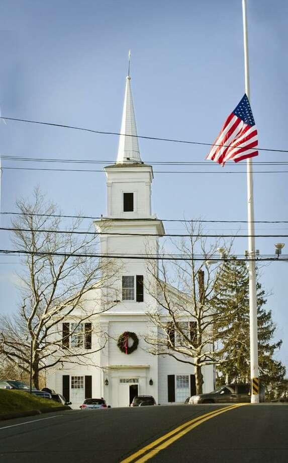 The American flag in Newtown flies at half mast near the Community Meeting House church. Melanie Stengel/Register