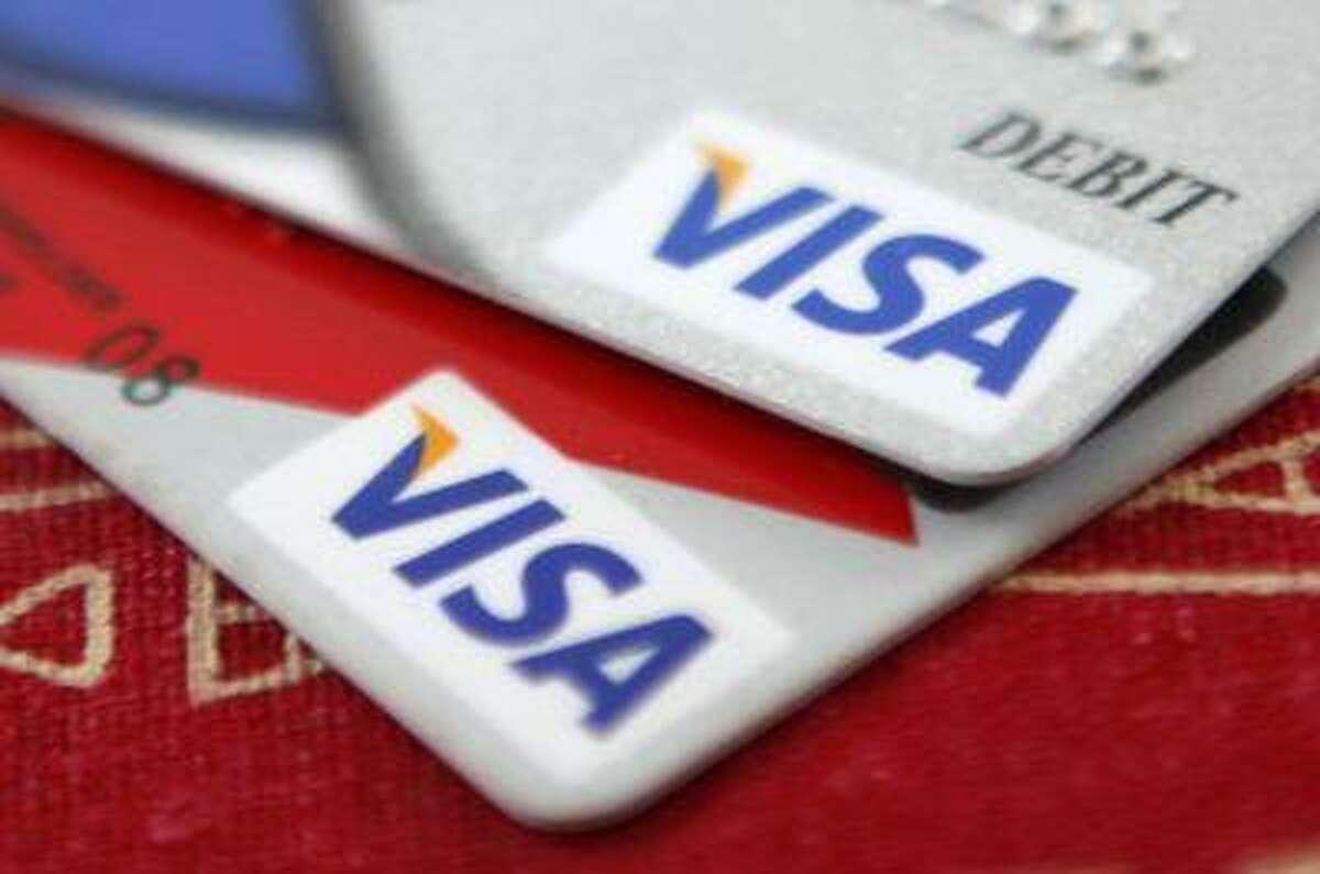 Visa credit cards are displayed in Washington October 27, 2009.