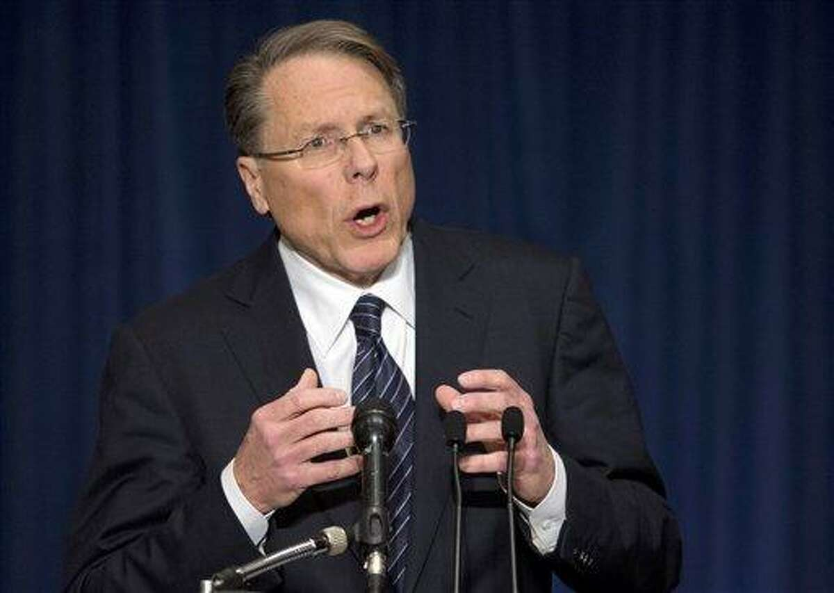National Rifle Association executive vice president Wayne LaPierre, gestures during a news conference in response to the Connecticut school shooting. The nation's largest gun-rights lobby is calling for armed police officers to be posted in every American school to stop the next killer