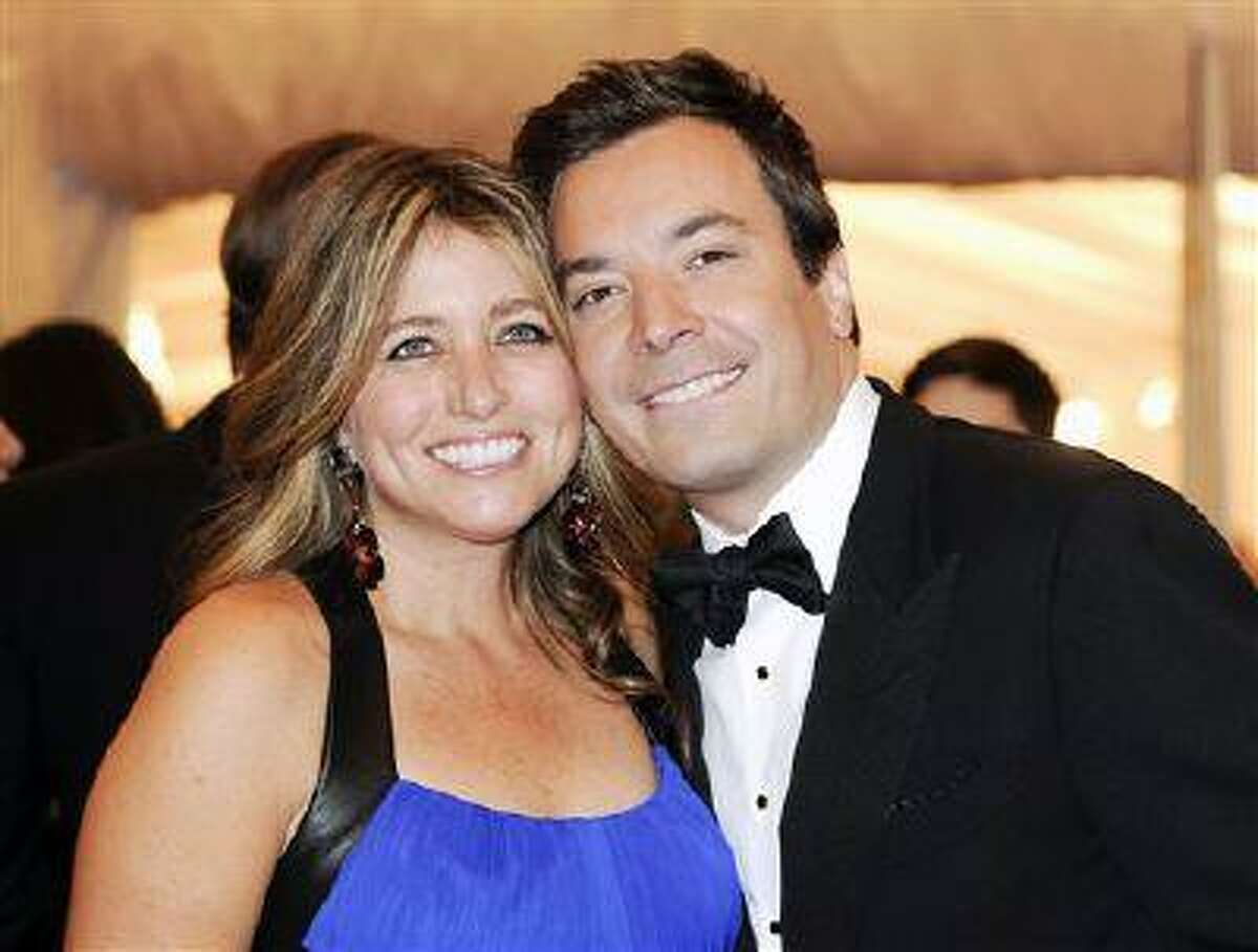 FILE - This May 7, 2012 file photo shows Jimmy Fallon and his wife Nancy Juvonen, left, at the Metropolitan Museum of Art Costume Institute gala benefit, celebrating Elsa Schiaparelli and Miuccia Prada in New York. A representative says Fallon and his wife, Nancy Juvonen Fallon, welcomed a baby daughter on Tuesday, July 23, 2013. (AP Photo/Evan Agostini, File)