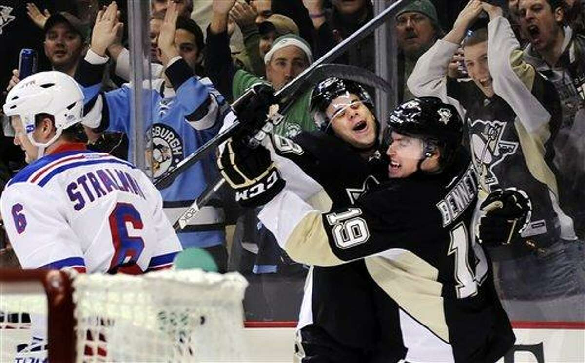 Pittsburgh Penguins' Beau Bennett (19) is congratulated by Tyler Kennedy after scoring on New York Rangers goaltender Henrik Lundqvist, not shown, as Anton Stralman (6) skates by in the first period of their NHL hockey game, Saturday, March 16, 2013, in Pittsburgh. The Penguins won 3-0. (AP Photo/Pittsburgh Post-Gazette, Matt Freed)