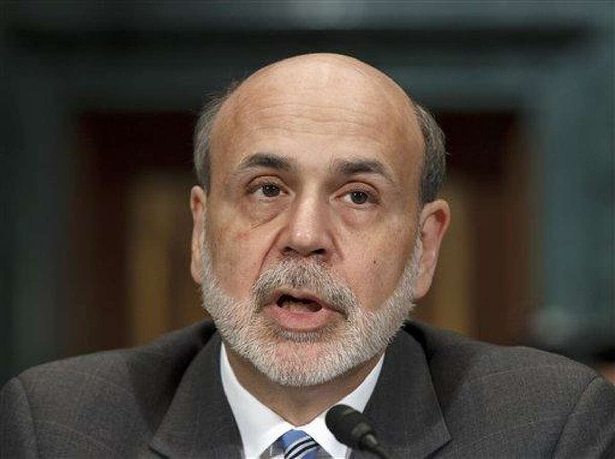 Federal Reserve Board Chairman Ben Bernanke testifies on Capitol Hill in Washington Thursday before the Senate Banking Committee to deliver his twice-a-year monetary report to Congress. Associated Press