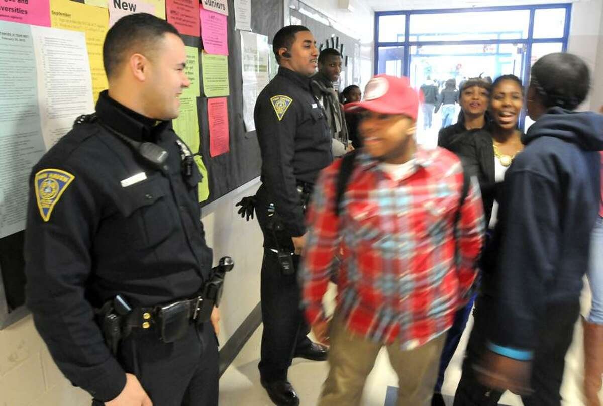 Two New Haven police officers, Martin Feliciano left and James Baker right, are assigned to Hillhouse High School as school resource officers. Mara Lavitt/New Haven Register3/15/13