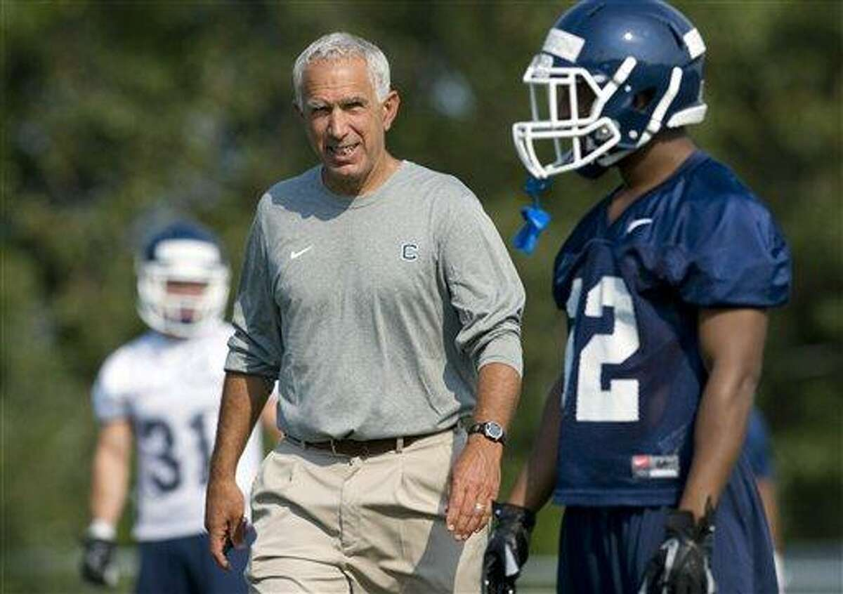 Connecticut coach Paul Pasqualoni watches players at NCAA college football practice in Storrs, Conn., Friday, Aug. 3, 2012. Connecticut's quarterback job is apparently sophomore transfer Chandler Whitmer's to lose as the Huskies begin fall practice on Friday. (AP Photo/Jessica Hill)