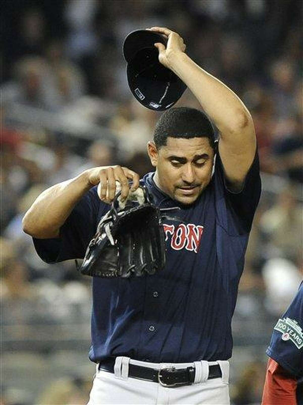 Boston Red Sox Franklin Morales reacts after giving up a solo home run to New York Yankees' Derek Jeter in the fifth inning of a baseball game on Friday, Aug., 17, 2012, at Yankee Stadium in New York. (AP Photo/Kathy Kmonicek)