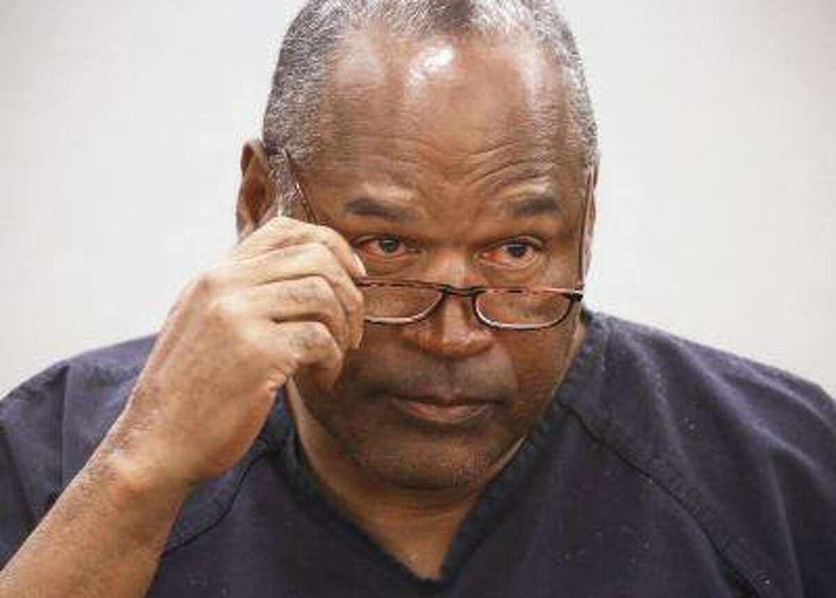 O.J. Simpson takes his glasses off during his evidentiary hearing testimony in Clark County District Court in Las Vegas, Nevada in this May 15, 2013 file photo.