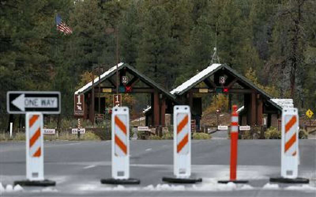 The main entrance to Grand Canyon National Park remains closed to visitors on Thursday Oct. 10, 2013, in Grand Canyon, Ariz. (AP Photo/Ross D. Franklin)