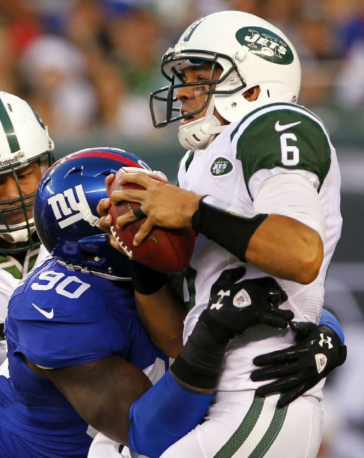 ASSOCIATED PRESS New York Giants defensive end Jason Pierre-Paul (90) sacks New York Jets quarterback Mark Sanchez (6) during the first half of a preseason game on Saturday in East Rutherford, N.J. The Giants won 26-3.