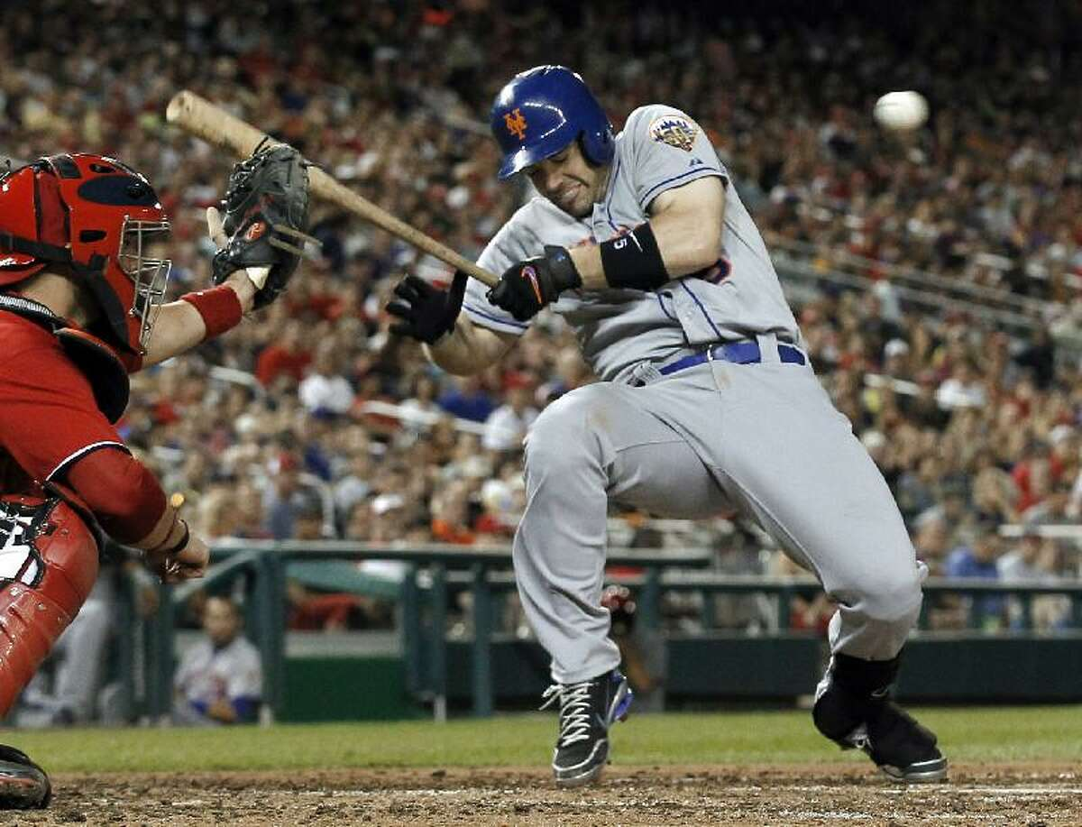 ASSOCIATED PRESS New York Mets' David Wright dodges away from ball four for a walk during the seventh inning of Saturday's game against the Washington Nationals at Nationals Park on Saturday in Washington. Wright scored on Ike Davis' home run. The Mets won 2-0.