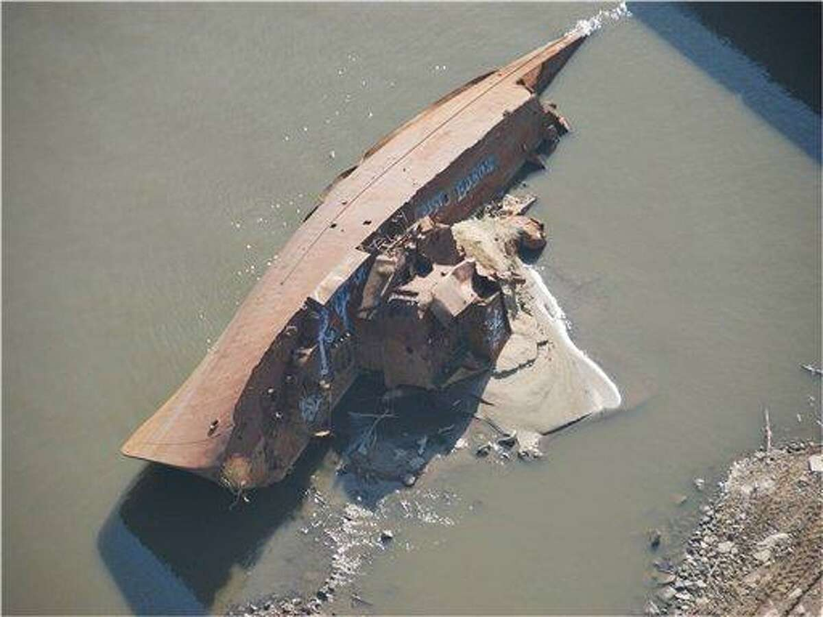 This Nov. 28, 2012 photo provided by The United States Coast Guard shows a WWII minesweeper on the Mississippi River near St. Louis, Mo. The lack of rain has left many rivers at low levels unseen for decades offering a glimpse at things not normally seen. The minesweeper, once moored along the Mississippi River as a museum at St. Louis before it was torn away by floodwaters two decades ago, has become visible _ rusted but intact. (AP Photo/United States Coast Guard, Colby Buchanan)