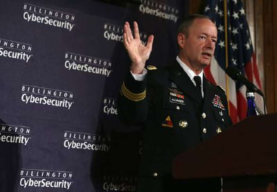Commander of U.S. Cyber Command and director of the National Security Agency (NSA) General Keith Alexander speaks during the fourth annual Cybersecurity Summit September 25, 2013 at the National Press Club in Washington, DC. General Alexander discussed 'media leak' and defended for the NSA surveillance program on American people. (Photo by Alex Wong/Getty Images) / 2013 Getty Images