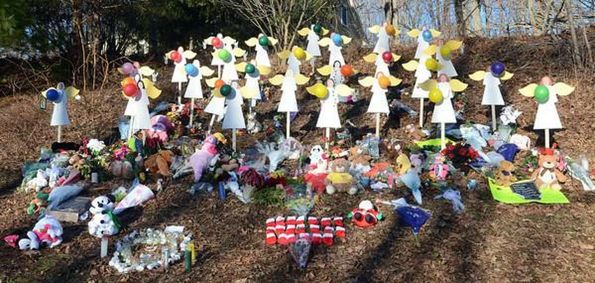 Staff photos by Tom Kelly IV A memorial along Church Hill Road in Sandy Hook, has 27 wooden angels for each of the 27 people killed last Friday. 20 students and 6 staff members of the Sandy Hook Elementary School, plus Nancy Lanza, the mother of the mass shooter.