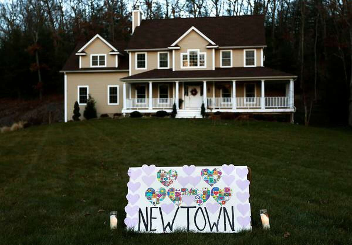"""A sign honoring the victims of the Sandy Hook elementary school shootings is seen outside a home in Sandy Hook, Connecticut December 15, 2012. Investigators assembled """"some very good evidence"""" to explain what drove a 20-year-old gunman to slaughter 20 children and six adults at an elementary school, police said on Saturday, a day after one of the worst mass shootings in U.S. history shattered a small Connecticut town. REUTERS/Shannon Stapleton"""