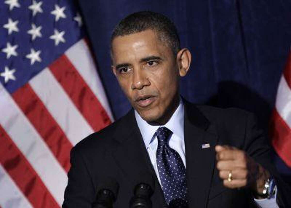 U.S. President Barack Obama delivers remarks at the Organizing for Action dinner in Washington, March 13, 2013.