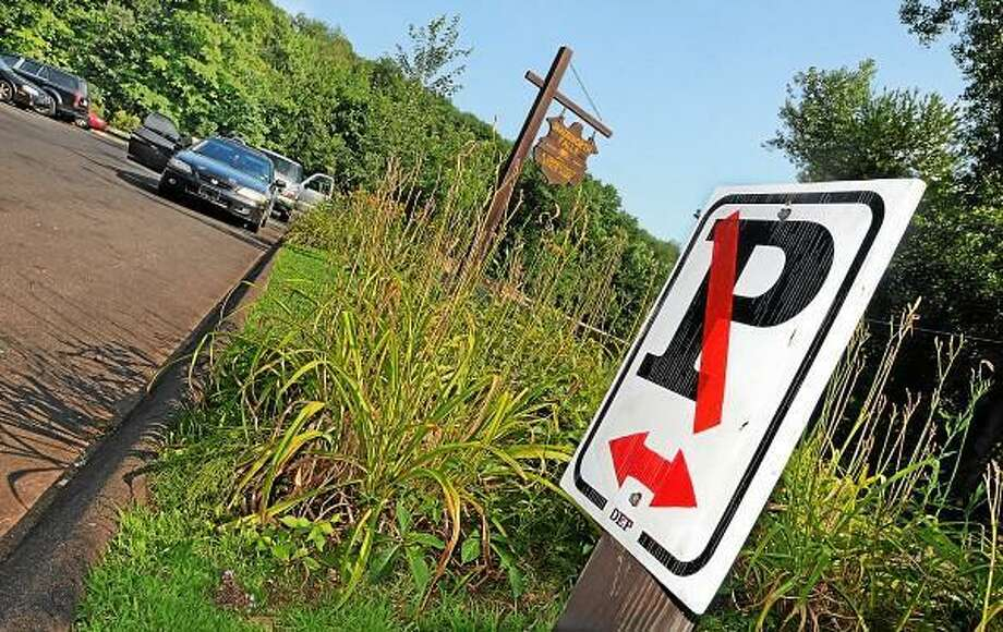 Catherine Avalone - The Middletown Press  Vehicles park temporarily in a no parking zone waiting for a free parking space at Wadsworth Falls State Park on Cherry Hill Road in Middlefield. / TheMiddletownPress