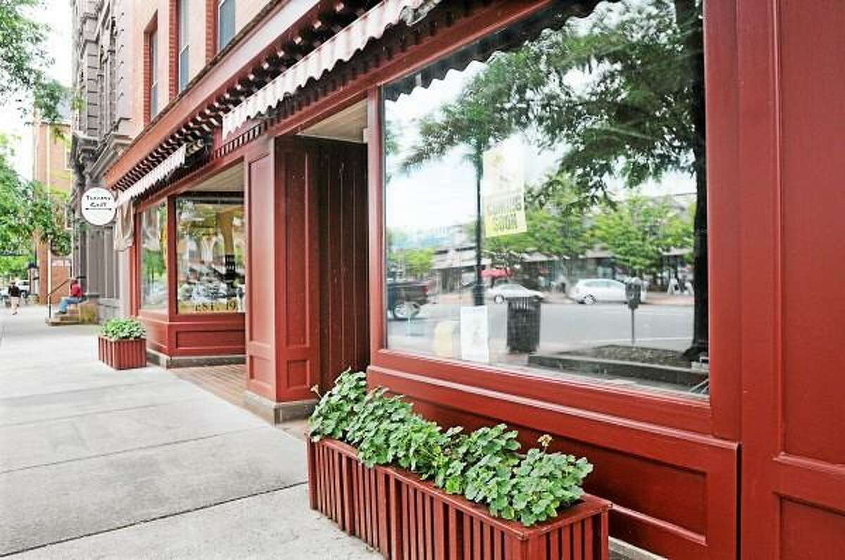 Walter Stojak and Lauren Rondinone, co owners of the Pickle Stand Delicatessen & Pub plan to open in the former Central News on Main Street in Middletown. Catherine Avalone - The Middletown Press