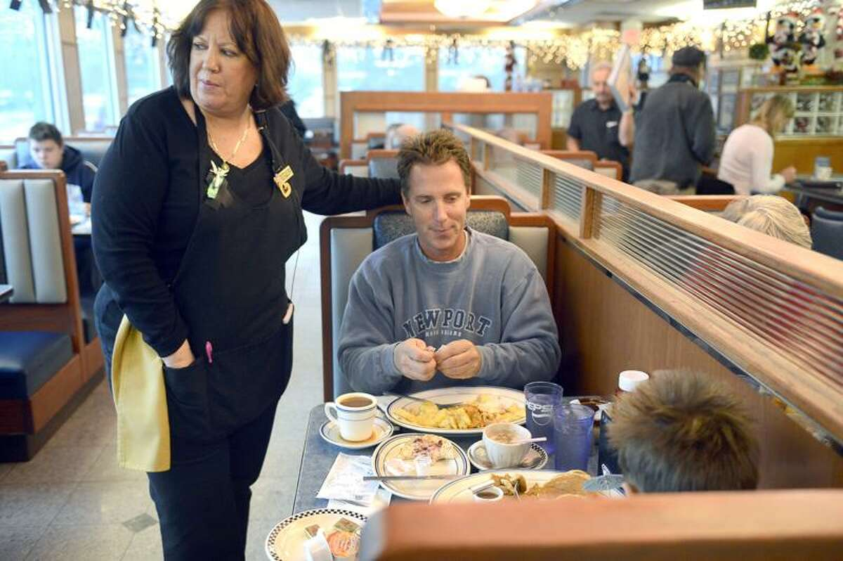 Nora Edery , a 25-year employee of the Blue Colony Diner, exclaimed that her favorite customers had arrived when Mark Edwards, of Newtown, and his 7-year-old son Cole walked in for breakfast. She watched over the pair giving Cole a pair of umbrellas and a straw for his hot chocolate.The diner serves as a respite for the people affected by the Sandy Hook shooting last week. People of all walks of life, mourners, those in uniform, journalists, and visitors, sit side by side in the diner for a hot cup of coffee and a bite to eat. December 21, 2012. Photo by Mahala Gaylord