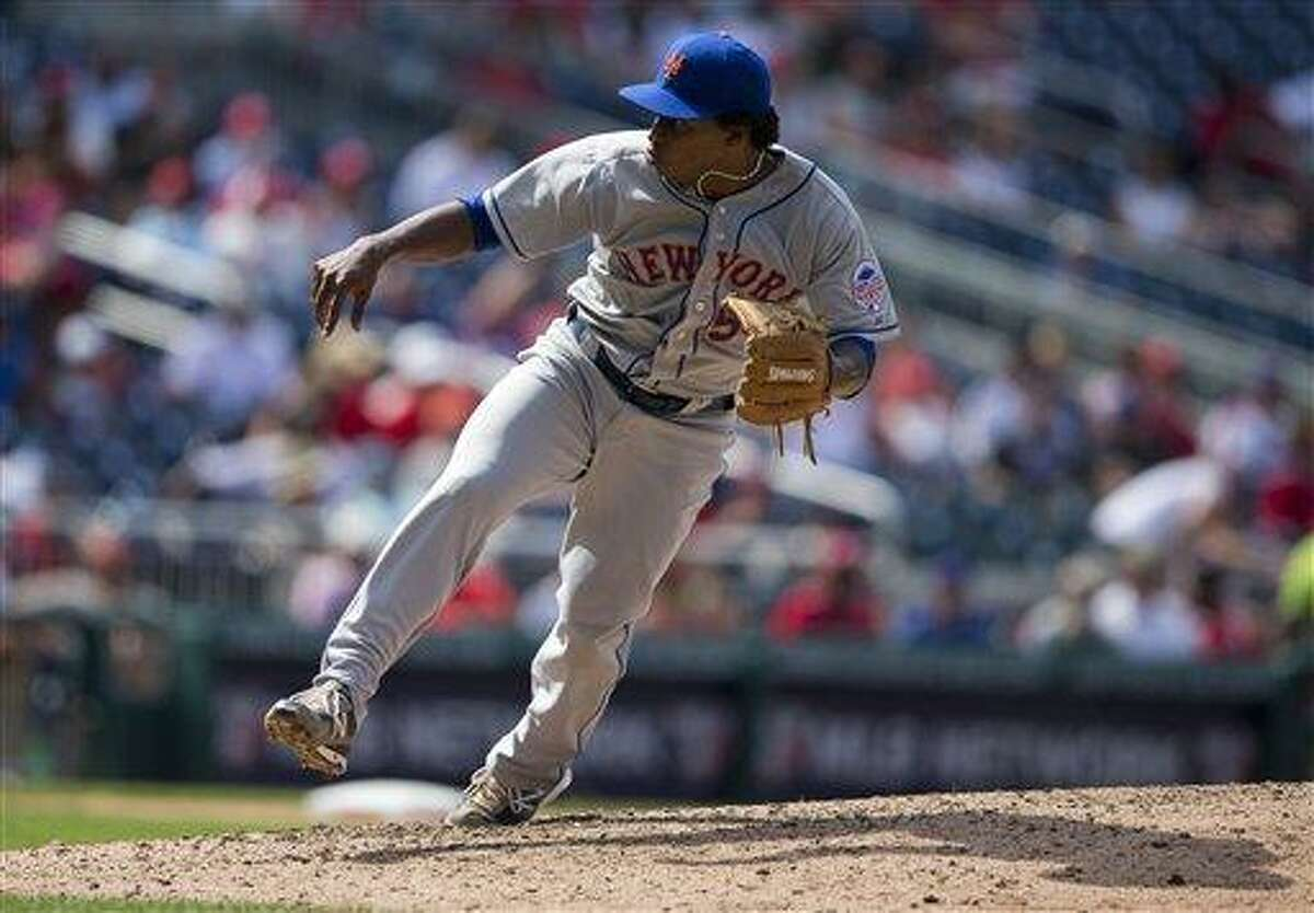 New York Mets starting pitcher Jenrry Mejia delivers a pitch during the seventh inning of a baseball game against the Washington Nationals at Nationals Park on Friday, July 26, 2013, in Washington. The Mets defeated the Nationals 11-0 in the first game of a doubleheader. (AP Photo/Evan Vucci)