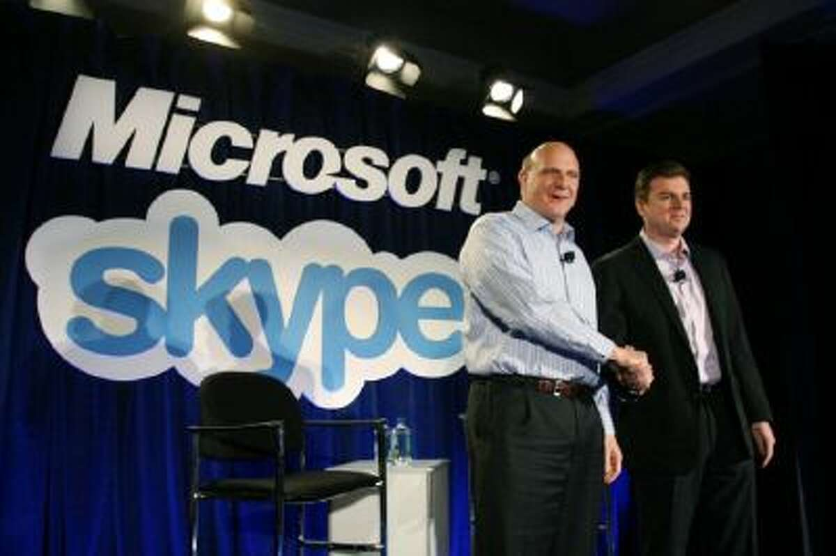 Microsoft CEO Steve Ballmer (L) shakes hands with Skype CEO Tony Bates during a news conference on May 10, 2011 in San Francisco, Calif. Microsoft has agreed to buy Skype for $8.5 billion.